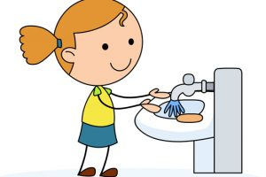 girl washing hands in a sink